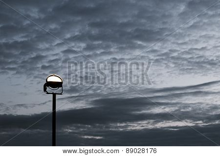 Reflector On The Background Of The Cloudy Sky