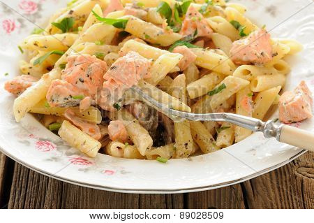 Creamy Pasta With Salmon And Parsley In White Plate Closeup Macro