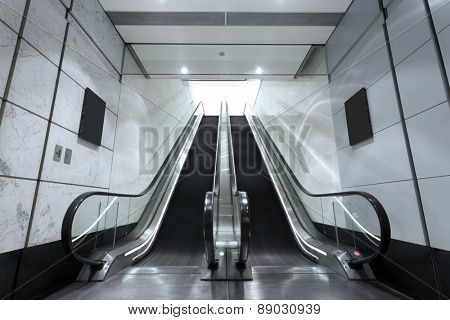 escalator in underground tunnel