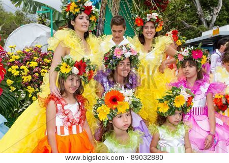 FUNCHAL MADEIRA - APRIL 20 2015: Performers with colorful costumes participate in the Parade of the