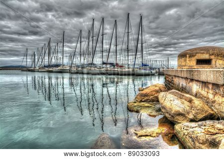 Old Bunker In Alghero Harbor Under A Dramatic Sky