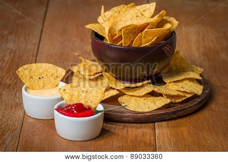 Mexican Nacho Chips And Cheese And Salsa Dip In Bowl