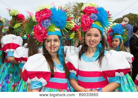 FUNCHAL MADEIRA - APRIL 20 2015: Girls with flower headdress at the Madeira Flower Festival Funchal