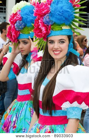 FUNCHAL MADEIRA - APRIL 20 2015: Beautiful young women with flower headdress at the Madeira Flower F