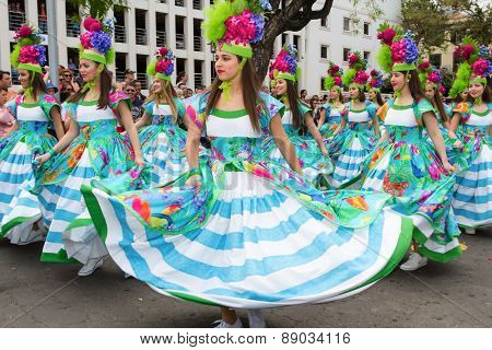FUNCHAL MADEIRA - APRIL 20 2015: Young girls dancing in the Madeira Flower Festival Funchal Portugal