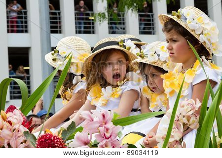 FUNCHAL MADEIRA - APRIL 20 2015: Children in floral costumes at the Flower Festival Parade Funchal M