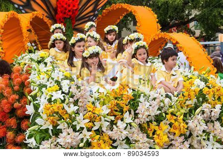 FUNCHAL MADEIRA - APRIL 20 2015: Children in a Floral Float at the Madeira Flower Festival Parade Fu