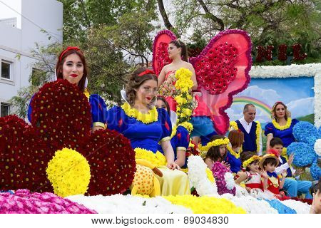 FUNCHAL MADEIRA - APRIL 20 2015: Participants in a Floral Float at the Madeira Flower Parade Funchal