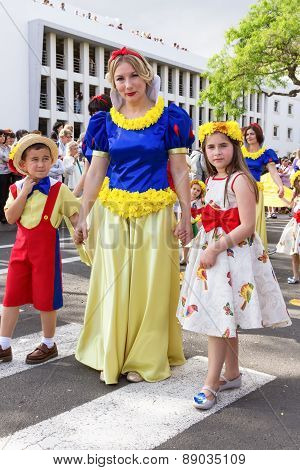 FUNCHAL MADEIRA - APRIL 20 2015: Woman and children with colorful floral costumes at the Madeira Flo