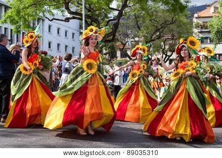 FUNCHAL MADEIRA - APRIL 20 2015: Dancers perform during of Flower parade at the Madeira Island Portu