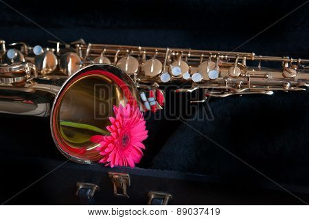 saxophone with flower