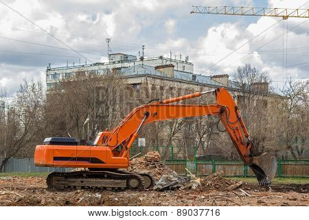 Excavator Removes Construction Waste After Building Demolition
