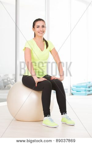 Beautiful sporty woman in gym