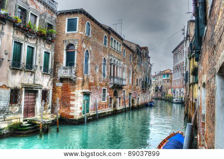 Narrow Canal In Venice Under A Gray Sky