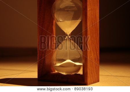 Sandglass in dark corridor