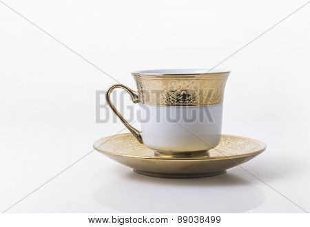An arabic golden coffee cup with saucer.
