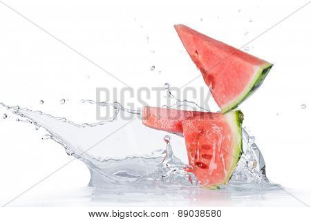 Fresh water melon with liquid splash over white background