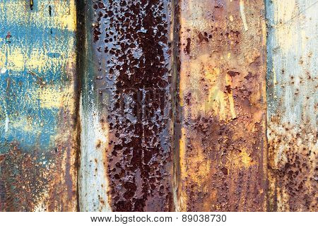 Red Rusted On The Color Metal Wall With Planks. Background And Texture For Your Design.