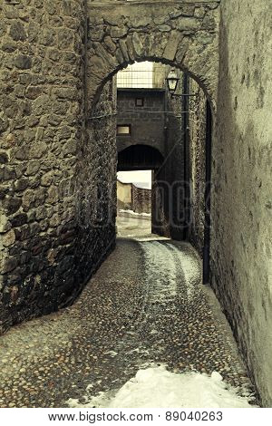 Rustic Arched Street In A Old Alpine Village