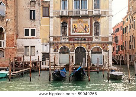 Old Venetian Houses And Gondola On The Grand Canal, Venice, Italy.