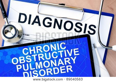 Form with diagnosis and tablet with chronic obstructive pulmonary disorder