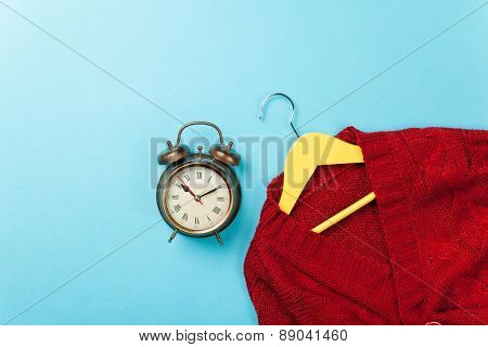 Alalrm Clock And Hanger With Sweater