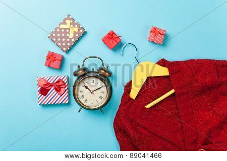 Clock And Hanger With Sweater Near Alarm Clock