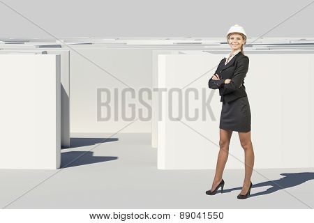 Businesswoman in hard hat looking at camera