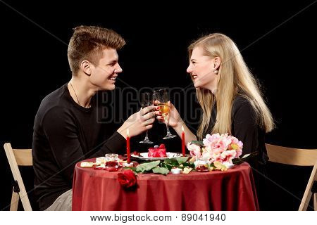 Portrait Of Romantic Couple Toasting white Wine At Dinner