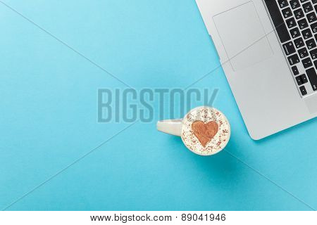 Cappuccino With Heart Shape And Laptop