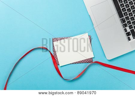 Mail And Laptop On Blue Background