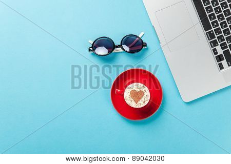Notebook And Coffee With Sunglasses