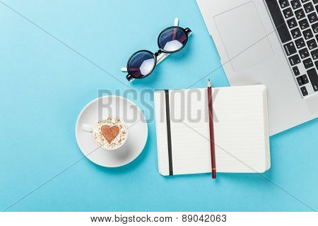 Cup Of Coffee And Laptop Near Glasses