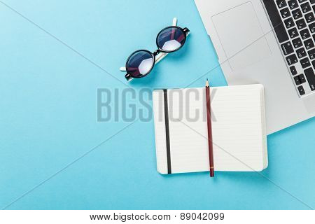 Notebook And Sunglasses Near Note