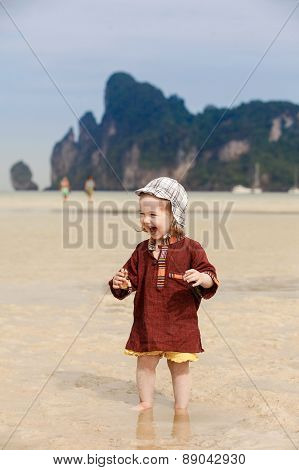 Child On Tropical Beach, Eating Bread
