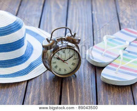 Alarm Clock And Hat With Flip Flops