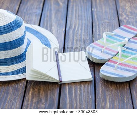 Notebook And Hat With Flip Flops