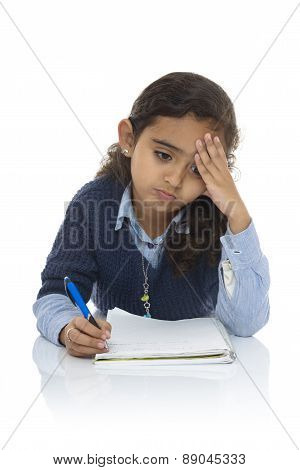 Cute Young Girl Studying Hard