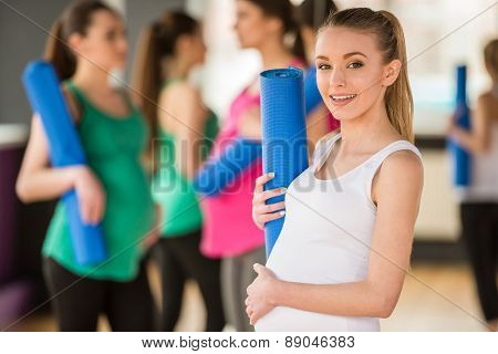Pregnant Women At Gym.