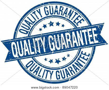 Quality Guarantee Grunge Retro Blue Isolated Ribbon Stamp