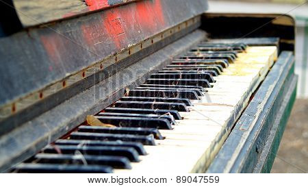 Old piano left outdoors