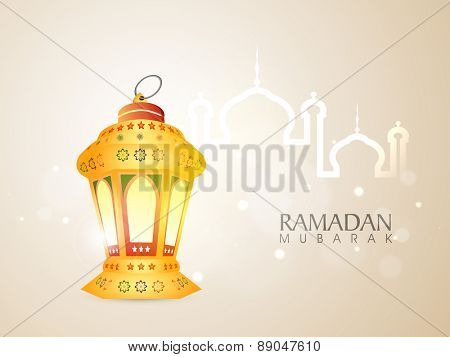 Illuminated traditional arabic lamp or lantern with islamic mosque for holy month of muslim community, Ramadan Kareem celebration.