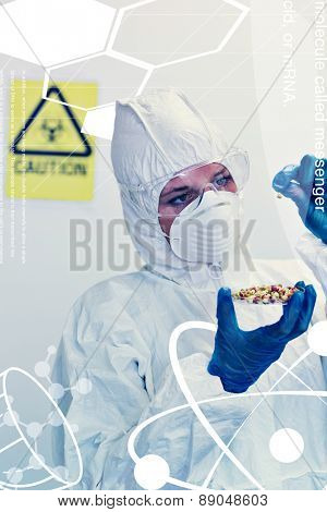 Science and medical graphic against scientist in protective suit with sprouts in laboratory