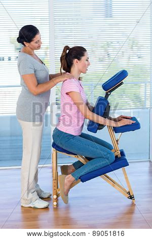 Woman having back massage in medical office