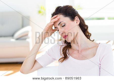 Brunette having headache on white background
