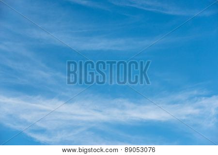 Blue sky background with soft white clouds
