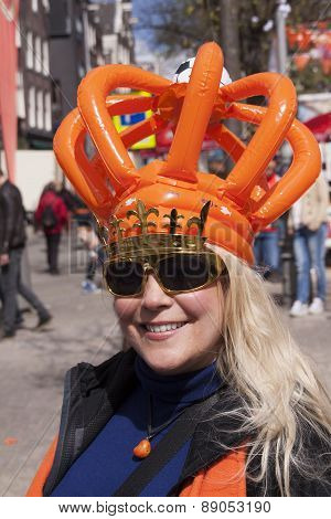Person Celebrating Kingsday In Outfit In Amsterdam