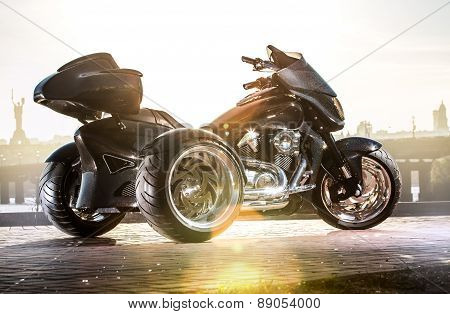 Black trike standing on the light street