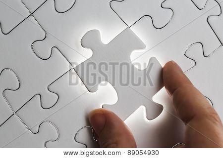Holding Jigsaw Piece