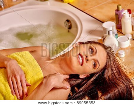 Woman relaxing at home luxury bath. Looking up.